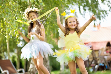 Two cute young girls as the ballet dancers photo