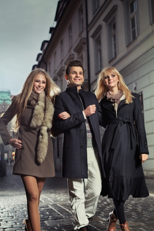 Elegant gentleman with two alluring girls photo