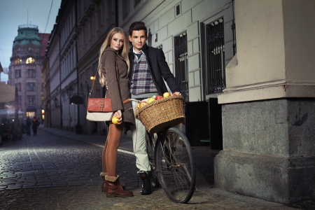 overcoat: Young attractive couple in the old town Stock Photo