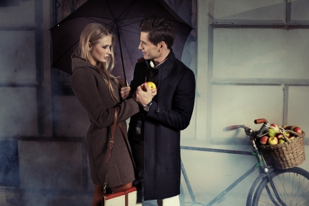 overcoat: Fine portrait of attractive couple