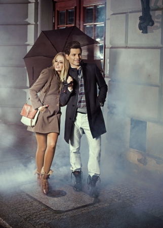 Cute couple with big umbrella photo