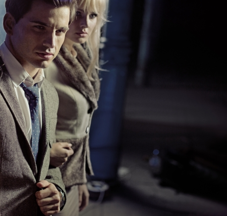 date night: Beautiful young couple walking together in night town