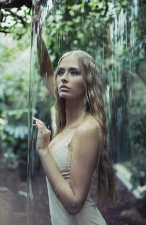 Young woman imprisoned in giant soap bubble photo