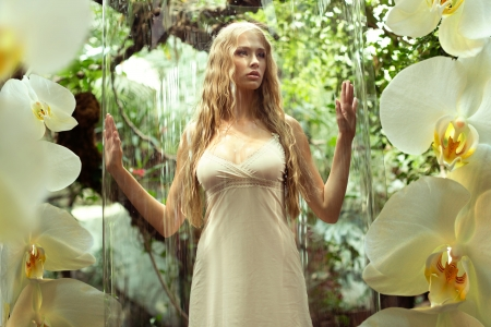Glass cage for cute young woman photo
