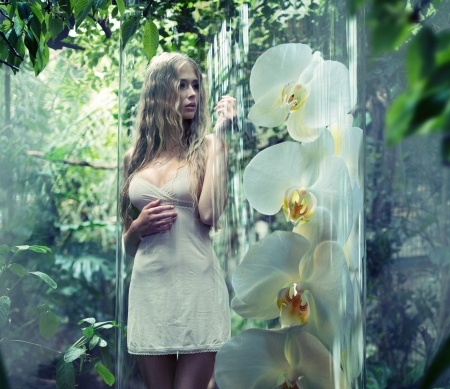 Cute blonde angel in glass cage photo