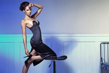 Elegant brunette lady in fashion pose