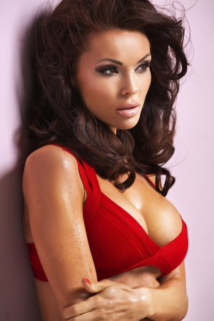 Alluring female model wearing deep red bra photo
