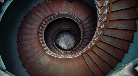downward: Great shot of ancient wooden spiral stairs