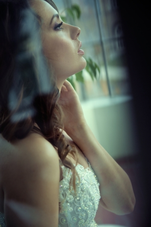 Profile portrait  of delightful young bride photo