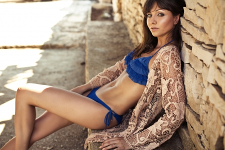 skinny woman: Skinny brunette woman relaxing in tropics
