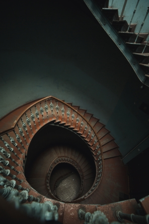 Ancient dark interior with long stairs photo