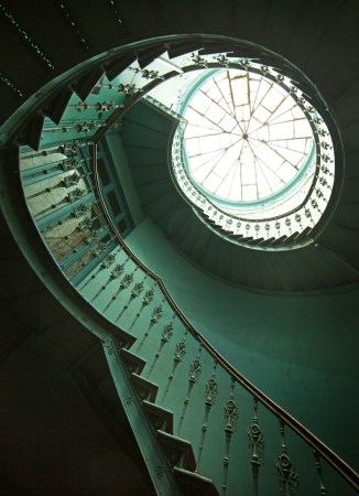 Art shot of old wooden spiral stairs photo
