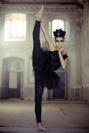 Fit young ballet dancer as a black swan Reklamní fotografie