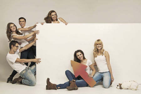advertising board: Funny photo of young people pulling white board