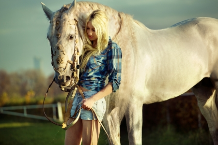 Portrait of a pretty blondie with horse photo