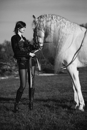 Black&white phoyo of redhead girl with horse photo