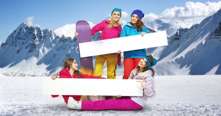 active arrow: Group of young  female snowboarders with bright boards