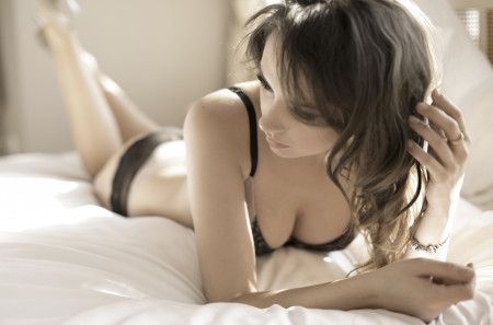 Alluring lady wearing tempting lingerie photo