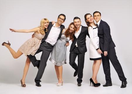 people: Grupo de jovens amigos rindo em pose fantasia