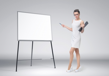 Business woman explain at the whiteboard