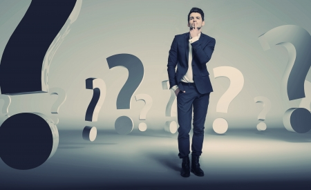 Handsome young businessman about questions photo
