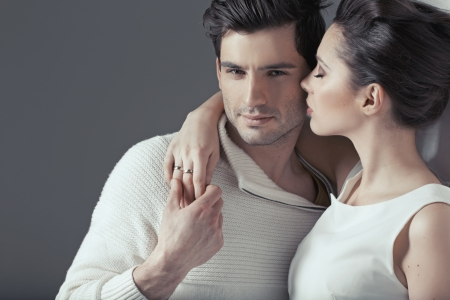 Young loving couple in sensual hug
