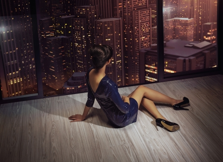 Attractive brunette woman looking at the panorama of the city photo