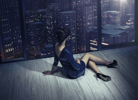Art photo of the woman in the apartment in the skyscraper
