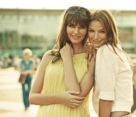 Two cheerful girlfriends with summer make-up photo