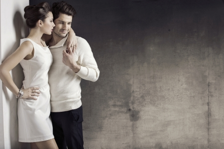 Slim woman with her muscular boyfriend photo