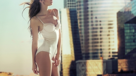 Sensual woman with the modern skyscrapers in the background photo