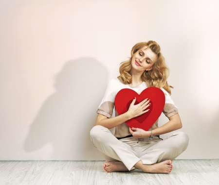 Relaxed young woman with valentines sign