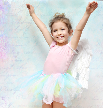 Cheerful little girl with beautiful smile photo
