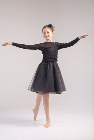 Young cute girl in the dance pose photo