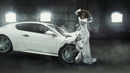 Alluring fashionable woman in the middle of car crash Stock Photo