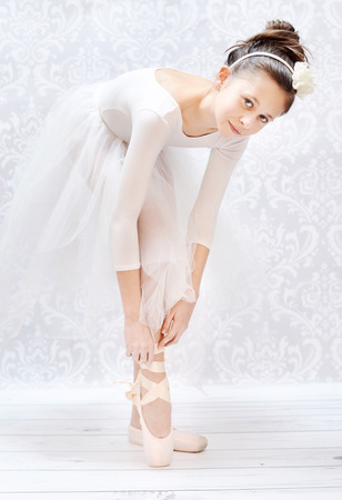 crucial: Cute little ballerina before crucial performance Stock Photo