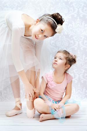 Two cute sisters practising ballet dance photo