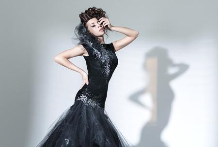 avantegarde: Elegant young lady wearing fancy dress