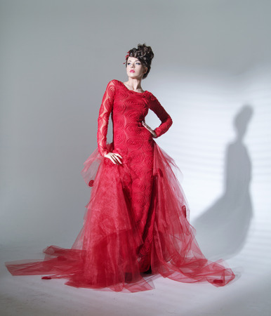 avantegarde: Proud red queen in the fashion pose