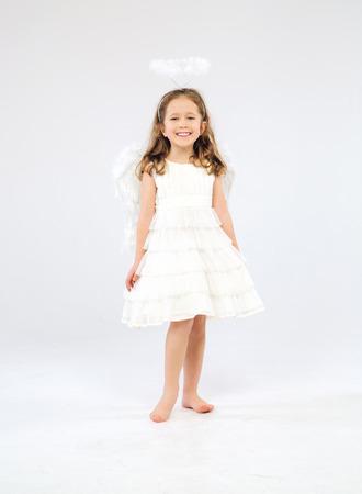 Cute little girl as an pure white angel photo