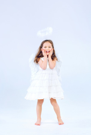 Angel child girl with pure white wings photo