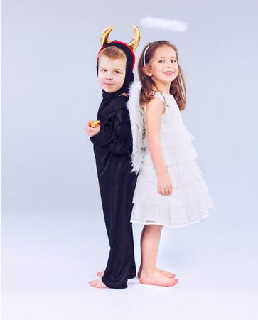 male angel: Cute little kids as devil and angel