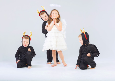 Little angel and three cute devils photo