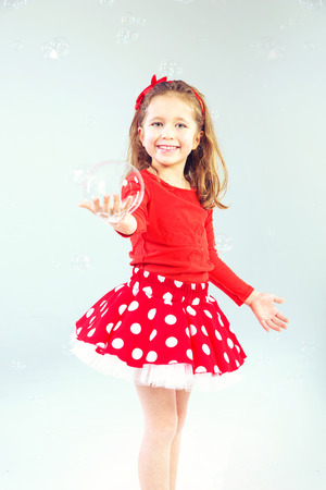 Little cute princess with soap bubbles photo