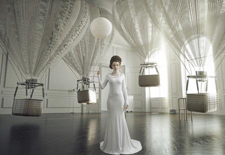 Fine art photo of a young fashion woman in a stylish interior Standard-Bild