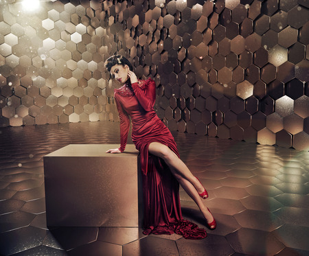 Sensual woman in shiny gold place