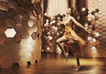 Dancing young lady wearing fabulous dress Stock Photo