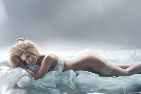 Alluring blonde woman in bed Stock Photo