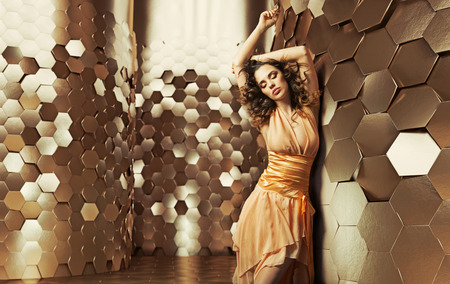 Brunette woman dancing in the shiny room Stock Photo