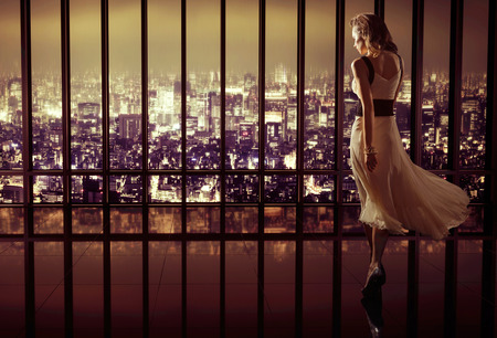 Young pretty woman in luxury modern apartment Stock Photo